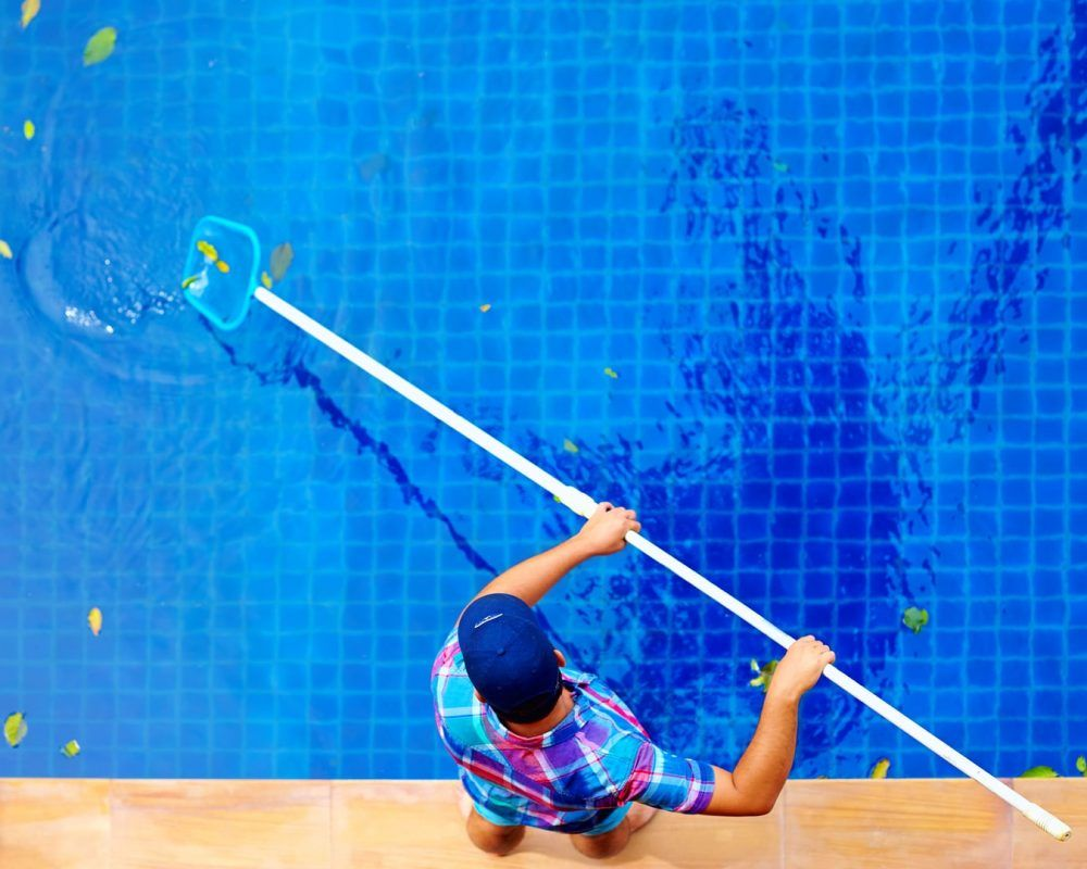 guy cleaning the pool