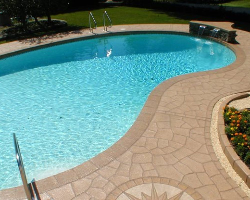 turquoise colored water in a pool with concrete resurfacing