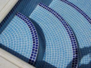 pool with blue tile floor finish